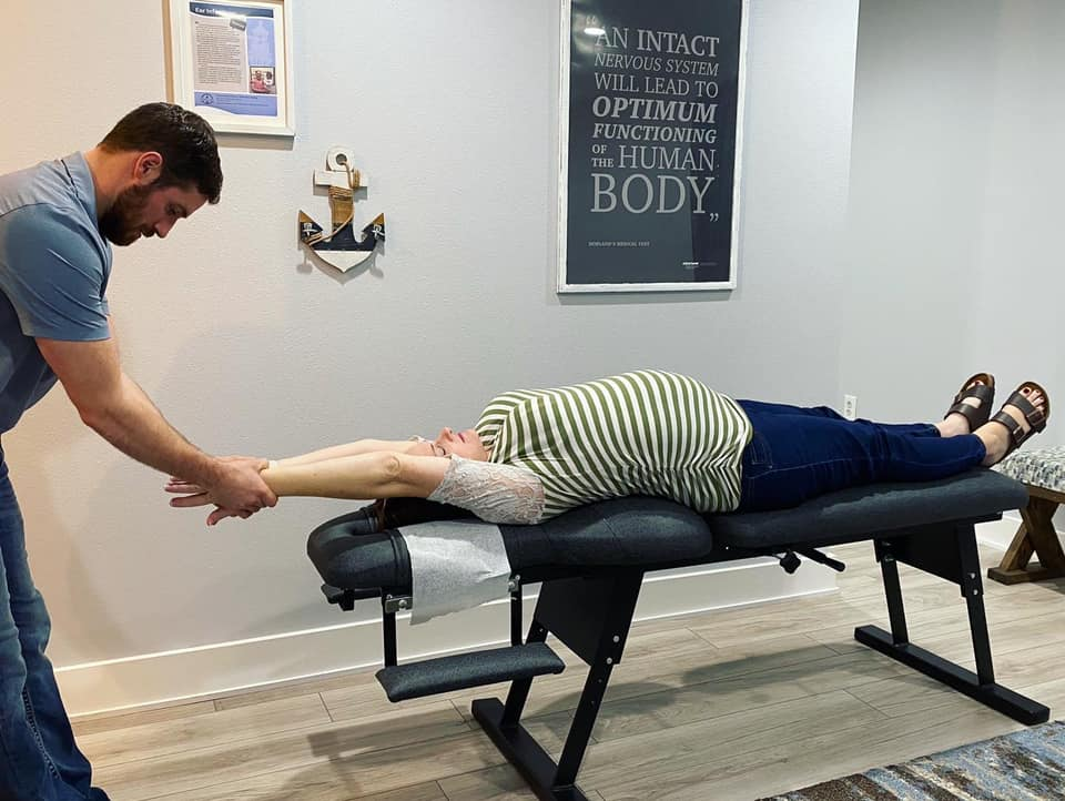 Doctor Gabriel Waterman providing adults with expert chiropractic care